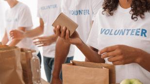 volunteers packing food bags