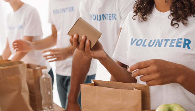 volunteers packing food bags