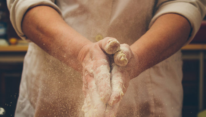 chef with flour on hands